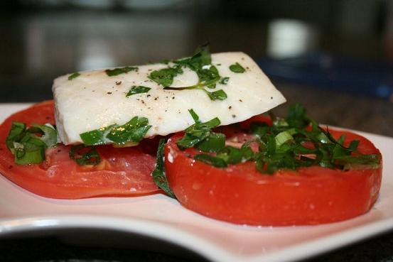 white fish baked over fresh tomato